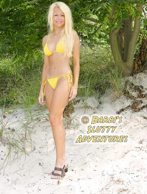 At beach in yellow bikini