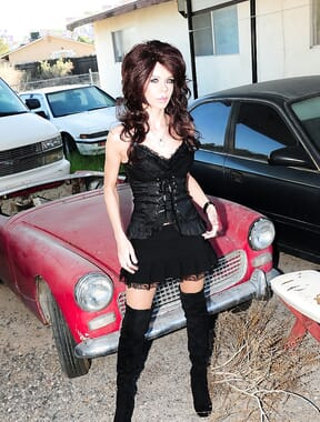 Dark haired beauty in junkyard